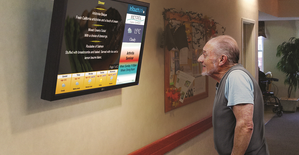 Man Looking at InTouchLink Screen