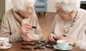 Retirement Home Resident Playing Dominoes