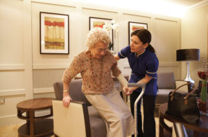 Caregiver helping senior lady